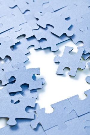 the puzzle pieces on white background photo