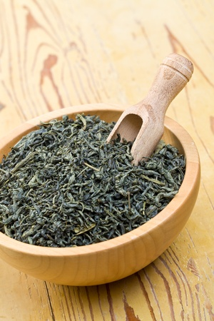 green tea leaves on kitchen table photo