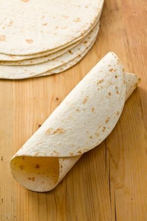 flour tortillas on wooden table photo