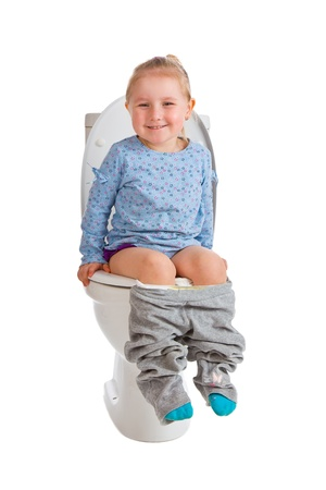 the little girl is sitting on toilet Stock Photo - 9305796