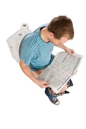 man is sitting on the toilet Stock Photo - 9305797