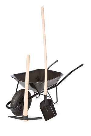 the wheelbarrow with shovel and pick photo