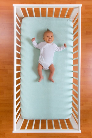 the top view of baby in cot photo