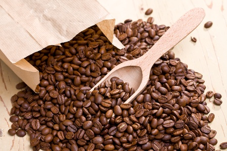 the coffee beans on wooden scoop Stock Photo - 9305905