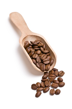 wooden scoop: the coffee beans on wooden scoop Stock Photo