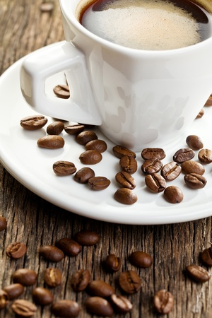 the cup of espresso with coffee beans photo