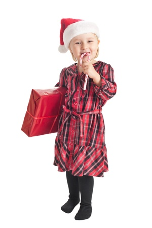 the studio shot of little girl with xmas gift photo