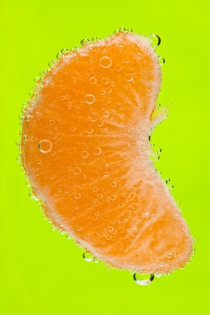 the tangerine with bubbles under water photo