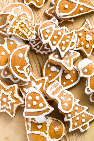 photo shot of christmas gingerbreads on wooden background photo
