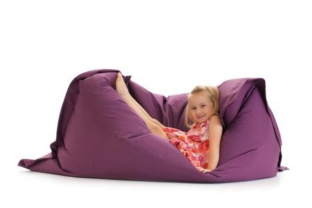 beanbag: the little girl posing on beanbag Stock Photo