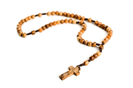 Wooden rosary beads on white background photo
