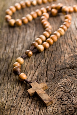rosary beads: Wooden rosary beads on old wooden background