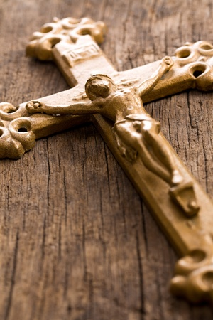 the crucifix on wooden background photo