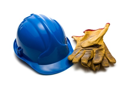 the blue hardhat and leather working gloves photo