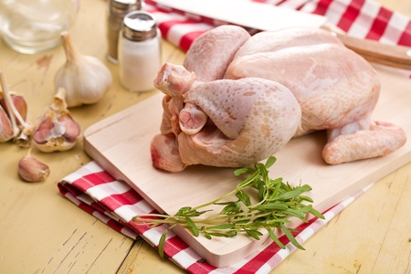 carcass meat: raw chicken meat on kitchen table