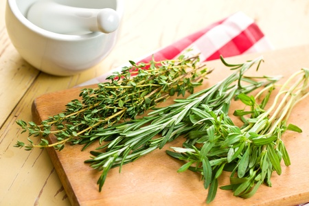 fresh herbs on kitchen table photo