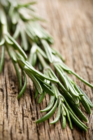 fresh rosemary on wooden table Stock Photo