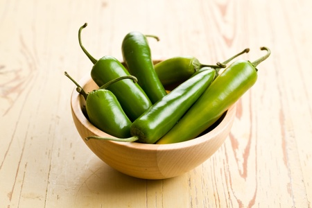 jalapeno pepper: Jalapenos Chili Peppers on kitchen table Stock Photo