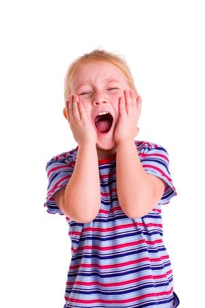 studio shot of little blonde girl screaming photo