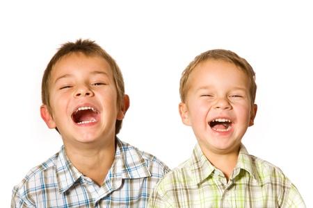 studio shot of two laughing boys Stock Photo