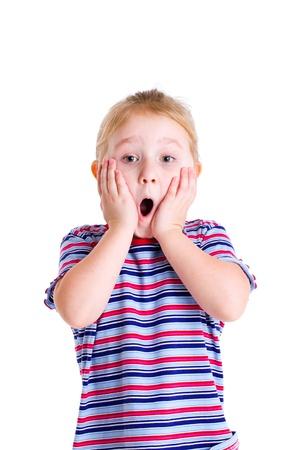 scared child: Foto de estudio de la cara de sorpresa de una ni�a Foto de archivo