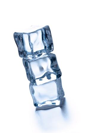 melting ice: the pile of three ice cubes Stock Photo