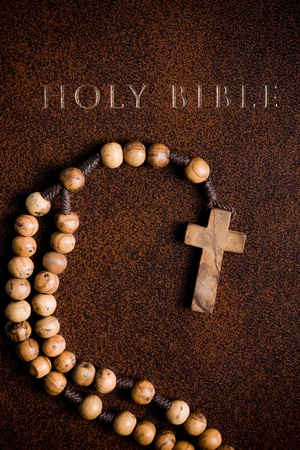 holy spirit: the wooden rosary on the Bible Stock Photo