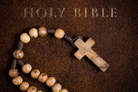 the wooden rosary on the Bible photo