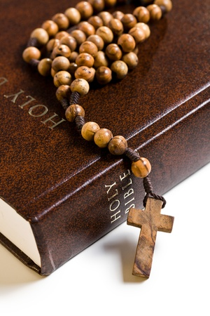 rosary beads: the wooden rosary on the Bible Stock Photo