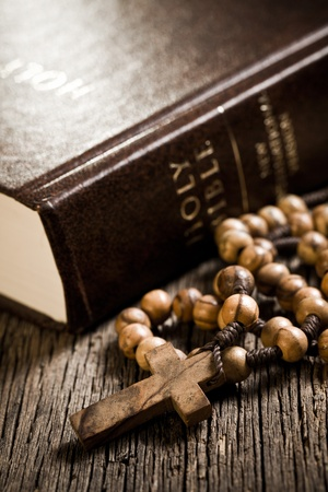 the wooden rosary and the Bible photo
