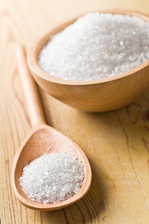 white salt in wooden spoon photo