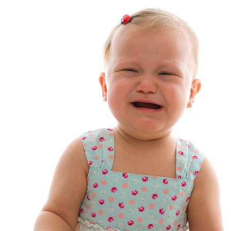 crying baby girl - studio shot over white photo