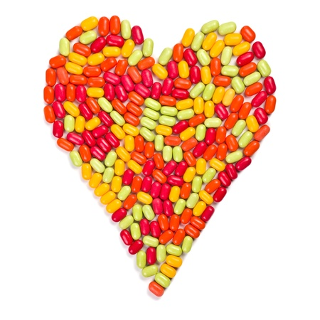 colorful candies heart on white background photo