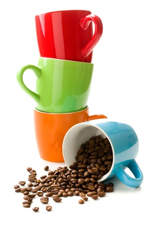 colorful mug with coffee beans on white background photo