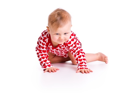 1 year old: the studio shot of baby crawling Stock Photo