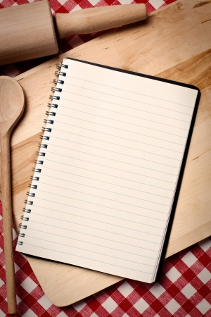 blank recipe book with wooden spoon photo