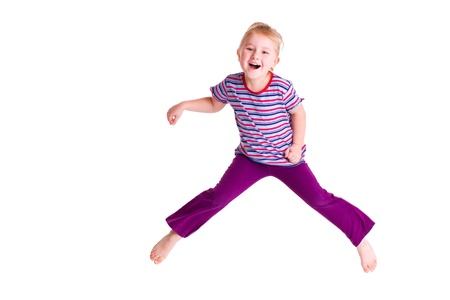 hand movements: the studio shot of young girl jumping
