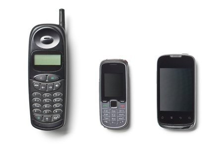 set of three generation cellphones on white background photo