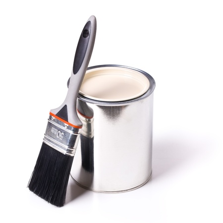 paint brush and tin can on white background photo