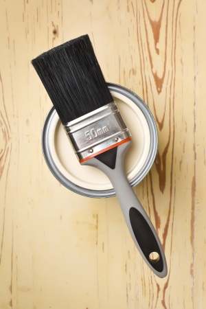 paint brush: paint brush and tin can on crackle wooden background Stock Photo