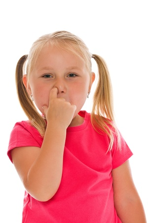 Little girl picking her nose   photo