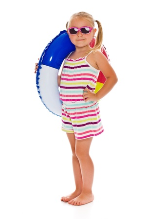 little girl with sunglasses and inflatable ring on white background photo
