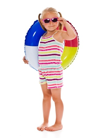 child swimsuit: little girl with sunglasses and inflatable ring on white background