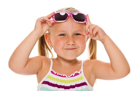 kids playing beach: little girl in sunglasses