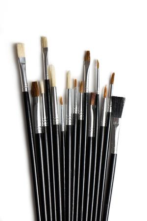 Set of paint brushes on white background photo