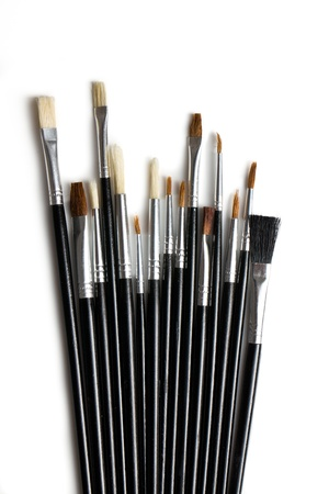 Set of paint brushes on white background photo