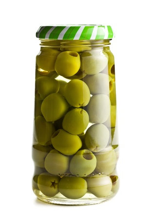 green olives in glass jar on white background photo