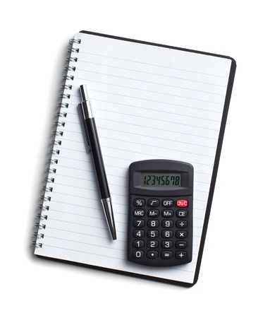 calculator and pen on blank notebook  Shot on white background photo