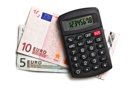 calculator and euro currency on white background photo