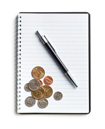 american coins and pen on blank notebook photo